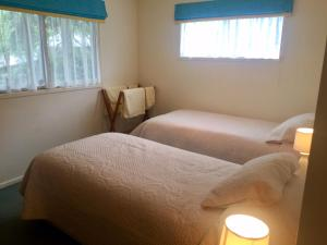 A bed or beds in a room at Fairways