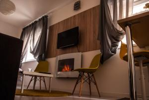 A television and/or entertainment center at Apartments Lisinski