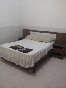 Cama o camas de una habitación en Casa Quadra da Praia Armação