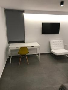 A television and/or entertainment centre at Dimokritou 4 Apartment