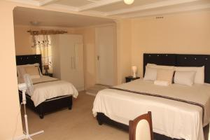 A bed or beds in a room at Demepran Self Catering