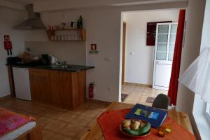 A cozinha ou kitchenette de Apartamento Alegre