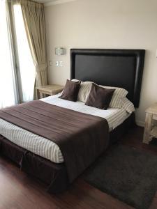 Cama o camas de una habitación en EH Homes Las Condes