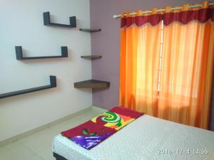 A bed or beds in a room at SP Plaza Service Apartment