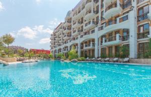 The swimming pool at or close to Harmony Suites Grand Resort