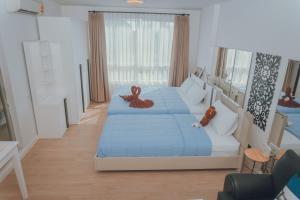 เตียงในห้องที่ บ้านเพียงเพลินคอนโด หัวหิน A 6/416