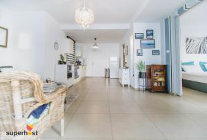 A kitchen or kitchenette at ★ SeaPenthouse/TLV-Beach/80M²Roof/PrivateParking ★