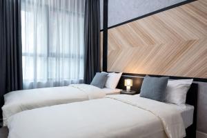 Posteľ alebo postele v izbe v ubytovaní Arte Plus by Afflexia Serviced Suites KLCC