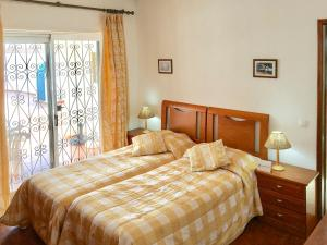 A bed or beds in a room at Benagil Villa Sleeps 9 Pool WiFi