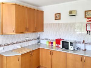 A kitchen or kitchenette at Benagil Villa Sleeps 9 Pool WiFi