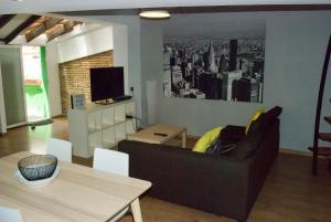 A seating area at RUZAFA. Nice apartment and Terrace.