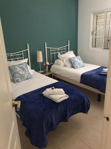 A bed or beds in a room at Las Velas apartment