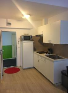 A kitchen or kitchenette at The Hague Shortstay