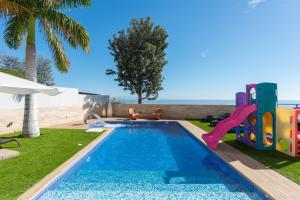 The swimming pool at or close to Santa Cruz Bay Luxury Villa