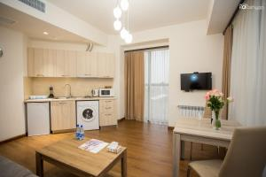 A kitchen or kitchenette at Welcome City Center Apartments