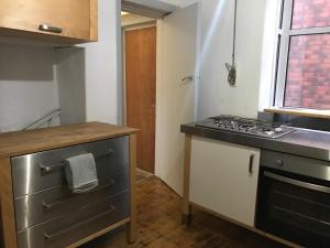 A kitchen or kitchenette at High Rid House