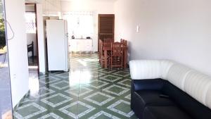 A seating area at Apartamento da Dona Rô