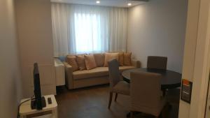 A seating area at Apartamentos Centro Colón