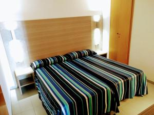 A bed or beds in a room at Apartamentos Jet - Adults Only