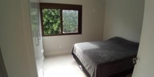 Cama o camas de una habitación en Apartamento Condomínio Praia do Santinho