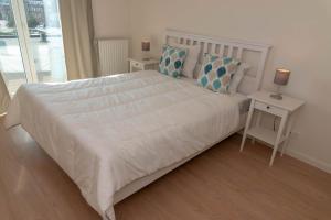 Een bed of bedden in een kamer bij Fort Imperial 03-02 Spuiplein Breskens