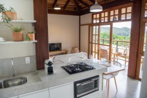 A cozinha ou cozinha compacta de Casas Gengibre