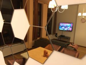 Een TV en/of entertainmentcenter bij Zuiderdokken Apartments