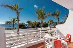 Een balkon of terras bij Rocas Blancas Apartments
