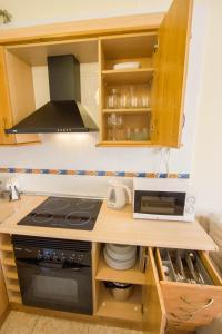 A kitchen or kitchenette at OLD TOWN apartment