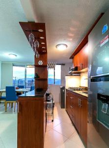 A kitchen or kitchenette at POBLADO APARTMENT