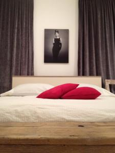 A bed or beds in a room at Apartments Kokolo