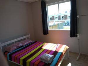 Cama o camas de una habitación en Apartamento 2 Quartos VG