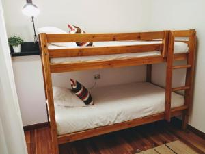 A bunk bed or bunk beds in a room at Mïlú Guesthouse