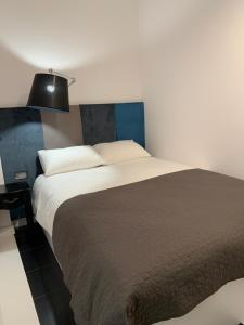 A bed or beds in a room at D&M Apart Suraska 4