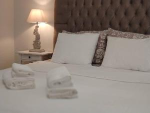 A bed or beds in a room at Seaside luxury house on best beach of Chios