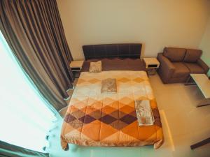 เตียงในห้องที่ Club Royal Wongamat Apartment Unit 611