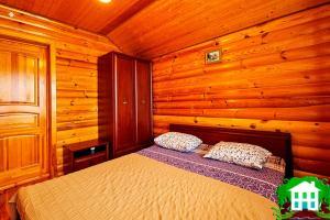 Кровать или кровати в номере Usad'ba Svetly Bereg