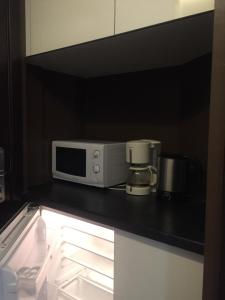 A kitchen or kitchenette at Barcelona Fifteen Luxury Aparthotel