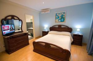 A bed or beds in a room at Villa Lopes