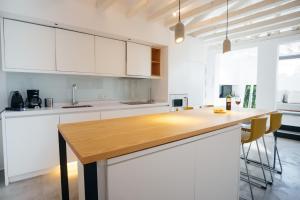 Küche/Küchenzeile in der Unterkunft Chueca Apartment - 2BR 2BT
