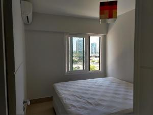 A bed or beds in a room at Apto Golden Gate