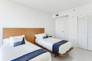 A bed or beds in a room at OB Brickell Miami