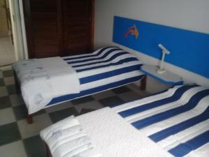 A bed or beds in a room at Pier 99 Suites