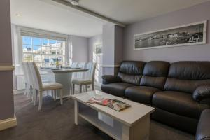A seating area at Barker Luxury Apartment, breathtaking sea views.