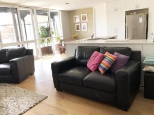 A seating area at Ocean Grove Beach House