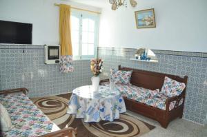 A seating area at City Apartment Mahdia free wifi