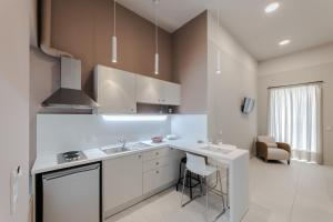 Η κουζίνα ή μικρή κουζίνα στο Stylish Studio Apartments-1878 House