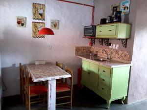 Una cocina o zona de cocina en Apart Boutique Floripa Cool