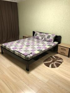 Кровать или кровати в номере Люкс апартаменты в центре Запорожье (рядом с отелем Интурист)