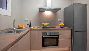 A kitchen or kitchenette at Exclusive Centric Apartments II